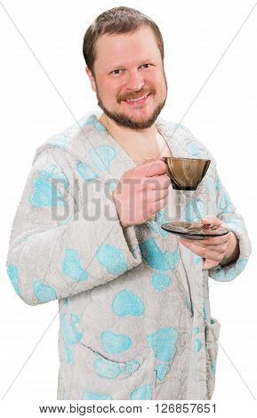 Middle-aged bearded man in bathrobe drinking coffe on white background