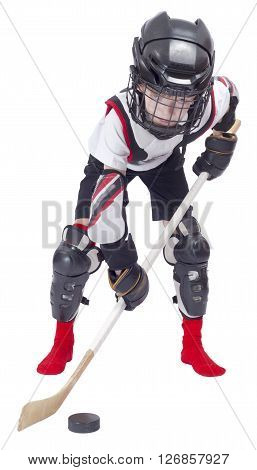 Young hockey player at ammunition on white background
