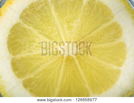 lemon slice macro with carbonate soda, refreshing image