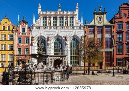 GDANSK, POLAND - APRIL 21, 2016: Street scene with Artus Court and Neptune Fountain in Gdansk. Old Town in Gdansk is a tourist attraction for visitors.