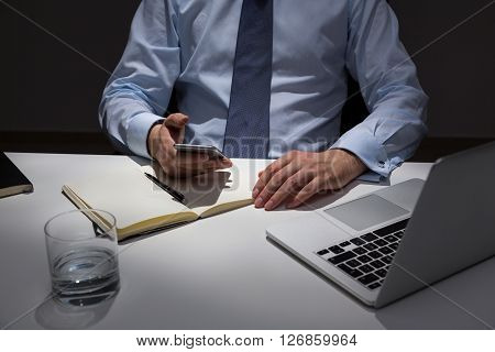 Using Smartphone Over Office Desk