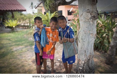Lahore Northeastern Apr 19 : Children caught lizards for sale or cooking at scrubland April 19.2016 in the northeast of Thailand .