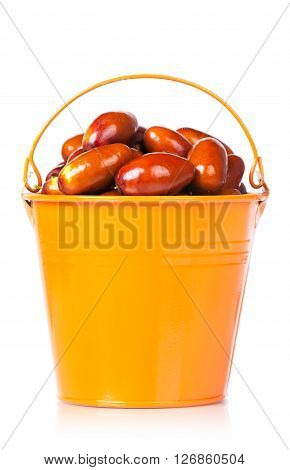 Raw jujube fruit in the garden bucket isolated on white background