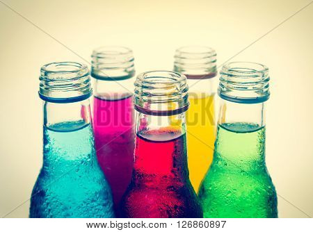 close up the cool colorful drink in the glass bottle