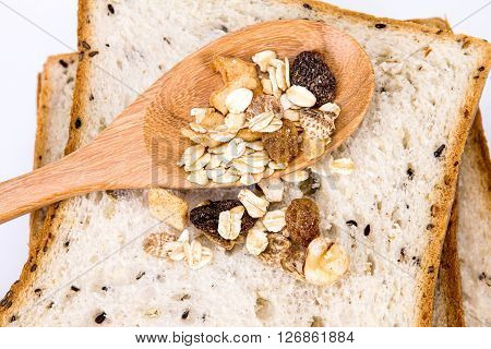 closeup the cereal and black sesame bread with whole grain cereal flakes which mixed warming cinnamon red skin apple golden raisins and roasted hazelnuts