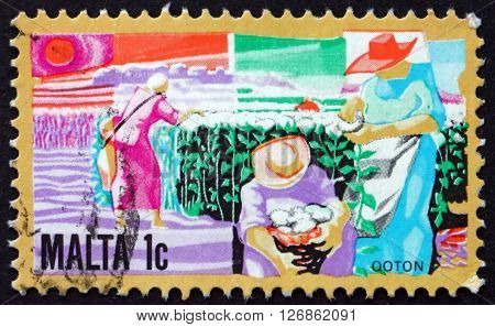 MALTA - CIRCA 1981: a stamp printed in Malta shows Growing Cotton circa 1981