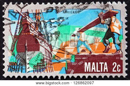 MALTA - CIRCA 1981: a stamp printed in Malta shows Ship Building circa 1981