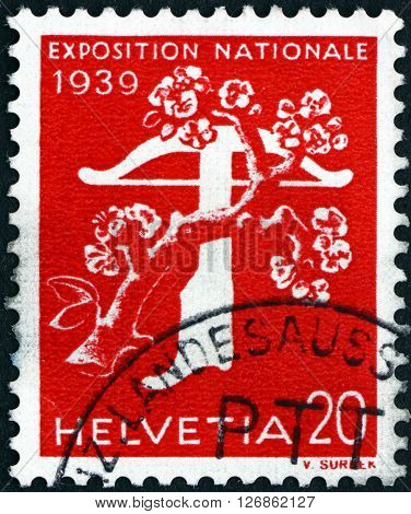 SWITZERLAND - CIRCA 1939: a stamp printed in the Switzerland shows Tree and Crossbow National Exposition of 1939 circa 1939