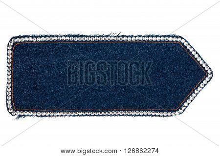 Arrow made of dark denim with rhinestones isolated on a white background