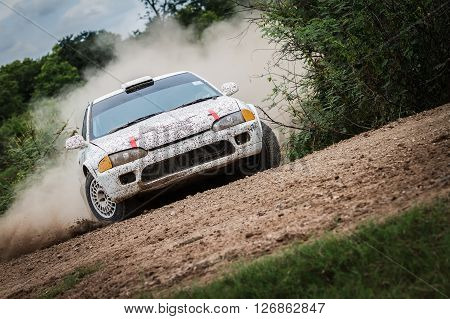 Dust splashed of rally car on dirt track