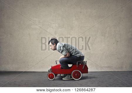 Man in a toy car