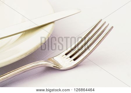Cutlery on a side plate high key