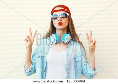 Pretty Cool Woman In Sunglasses And Red Cap Having Fun Over White Background