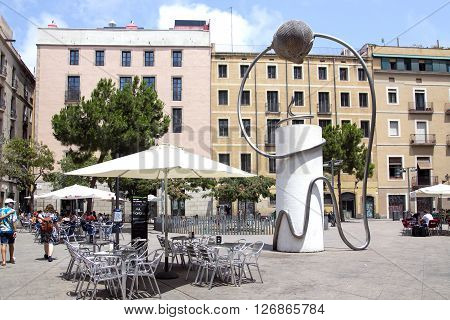 SPAIN, BARCELONA, JUNE, 27, 2015 - Small Art sculpture in the Gothic Quarter next to the summer cafe, Barcelona, Spain