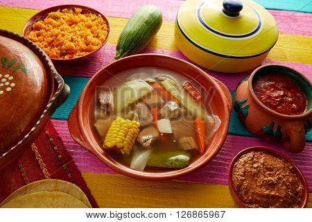 Caldo de res Mexican beef broth in table with sauces
