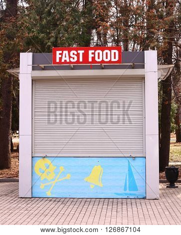 closed fast food booth with jolly roger sign