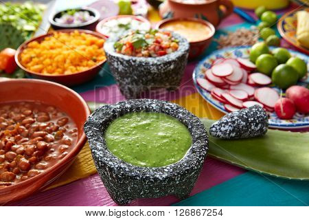 Green sauce with tomato and chili pepper in a mexican food table