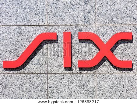 Zurich, Switzerland - 20 April, 2016: sign on the wall of the SIX Swiss Exchange building. SIX Swiss Exchange is the leading Swiss stock exchange for the trading of shares, bonds and investment funds.