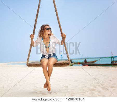Beautiful Happy Girl On A Swing On The Beach. Holiday, Vacation, Travel
