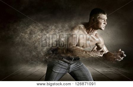 Bodybuilder drops splashing on thegrunge background