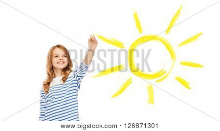 education, school and happy people concept - cute little girl drawing big sun in the air
