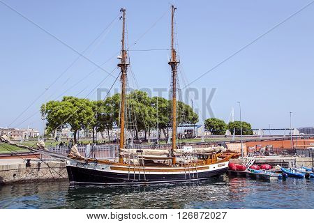 SPAIN, BARCELONA, JUNE, 27, 2015 - View of the ancient sailing ship at Port in Barcelona, Catalonia. Located east of the Port of Barcelona, it hosted the sailing events for the 1992 Summer Olympics.