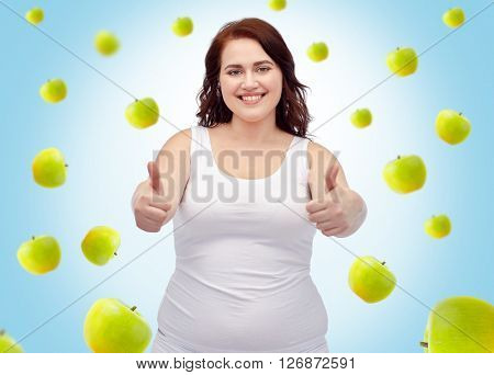 weight loss, diet, slimming, healthy eating and people concept - smiling young plus size woman in underwear showing thumbs up over blue background with green apples