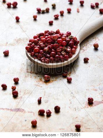 Red Peppercorn Seeds On Steel Plate