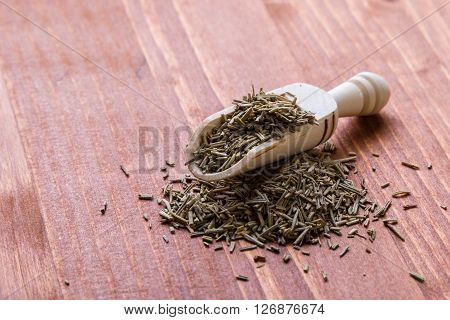 Rosemary Leaves On Wooden Table