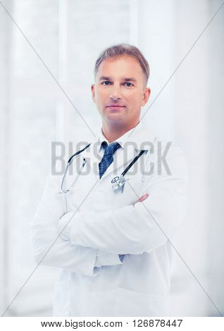 healthcare and medical concept - male doctor with stethoscope