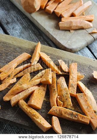 Fresh Cut Slices Of Sweet Potatoes Made Into Fries With Herbs