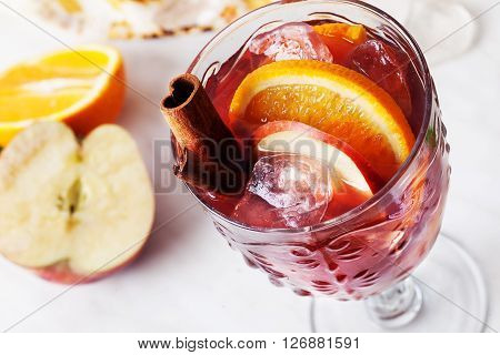Sangria in a glass ice orange apple cinnamon on top wine