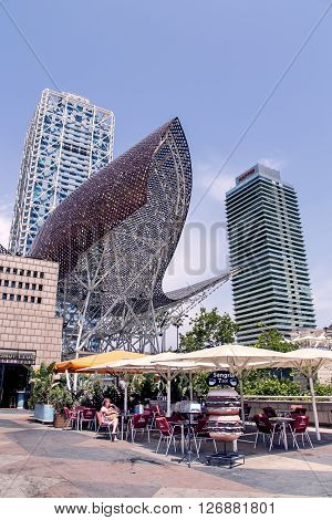 SPAIN, BARCELONA, JUNE, 27, 2015 - Frank Gehrys Golden Fish  is located in Barcelonas Vila Olimpica, Barcelona, Catalonia, Spain. The Golden Fish looks down on Barcelonas beach and is a striking feature in the seafront skyline.