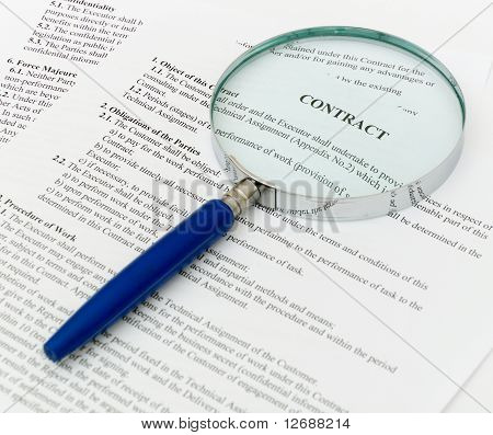 contract with a magnifying glass