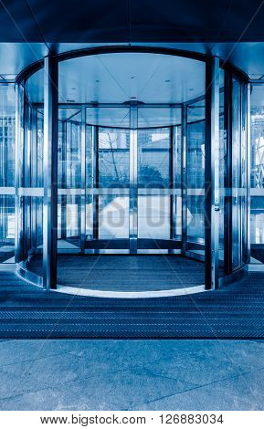 Revolving door ,blue toned image.