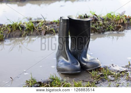 Rain boots rubber boots standing on water