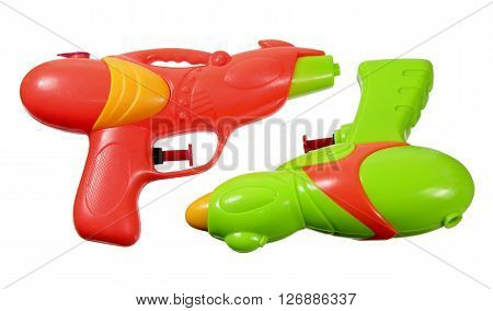 Plastic Water Pistols on Isolated White Background