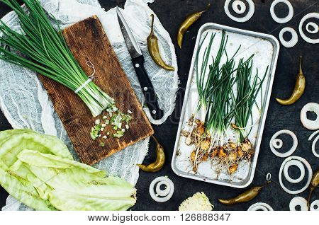 Onion beet pepper garlic carrot cabbage ready to prepare salad. Detox and diet food. Composition of organic veggies. Vegetable food background. Red and green veggies composition on a black table