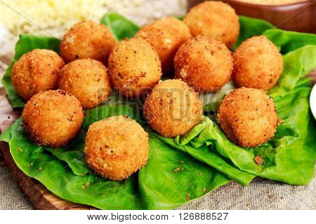 Fried mozzarella cheese stick balls. and ingredients.