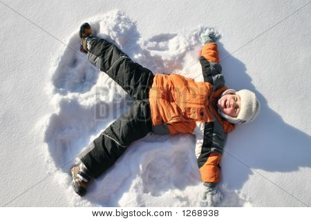 Boy Lies On North Pole Snow