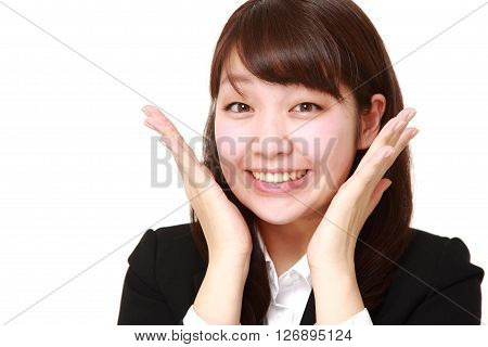 studio shot of young Japanese businesswoman pleased