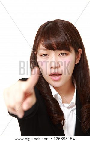 studio shot of young Japanese businesswoman scolding on white background