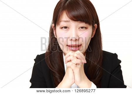 portrait of businesswoman folding her hands in prayer