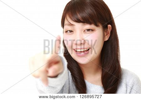 studio shot of Japanese woman decided   on white background