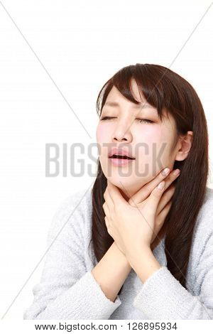 young Japanese woman having throat pain on white background