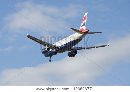 ST. PETERSBURG, RUSSIA - MARCH 20, 2016: Airbus A320-232 (G-EUYM) British Airways flies in a cloudy sky