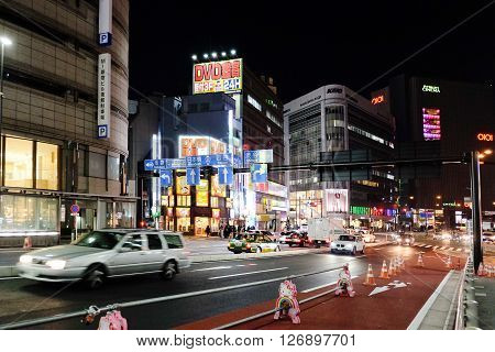 TOKYO - MARCH 31, 2016: Street life at night in Shinjuku on March 31, 2016 in Shinjuku Tokyo,Shinjuku is one of the busiest districts of Tokyo.It is a major commercial and administrative center.
