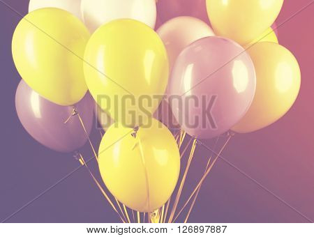 Colorful balloons on dark background. Retro style