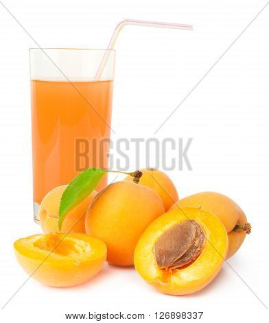 Glass of apricot juice and apricots with leaf isolated on white.