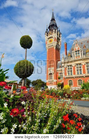 Tower Of Hotel De Ville In Calais, France, With A Floral Composition